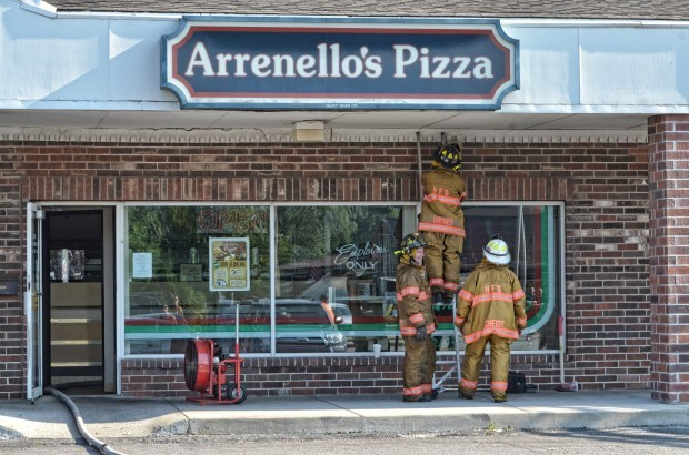 Highland plaza fire damages pizzeria and bakery