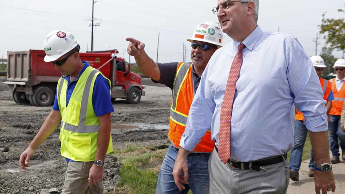 Holcomb inspects 'transformational' road-rail realignment under construction in Munster