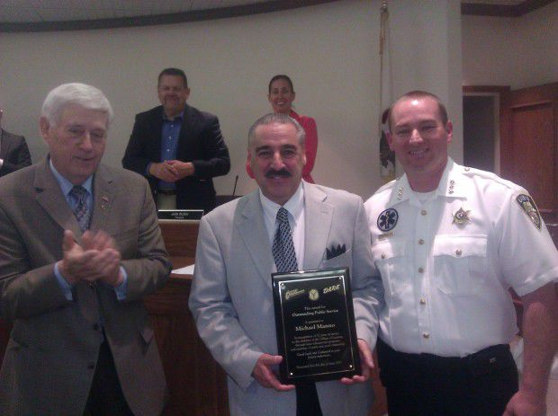Newly elected trustee honored for longtime contributions to Lansing