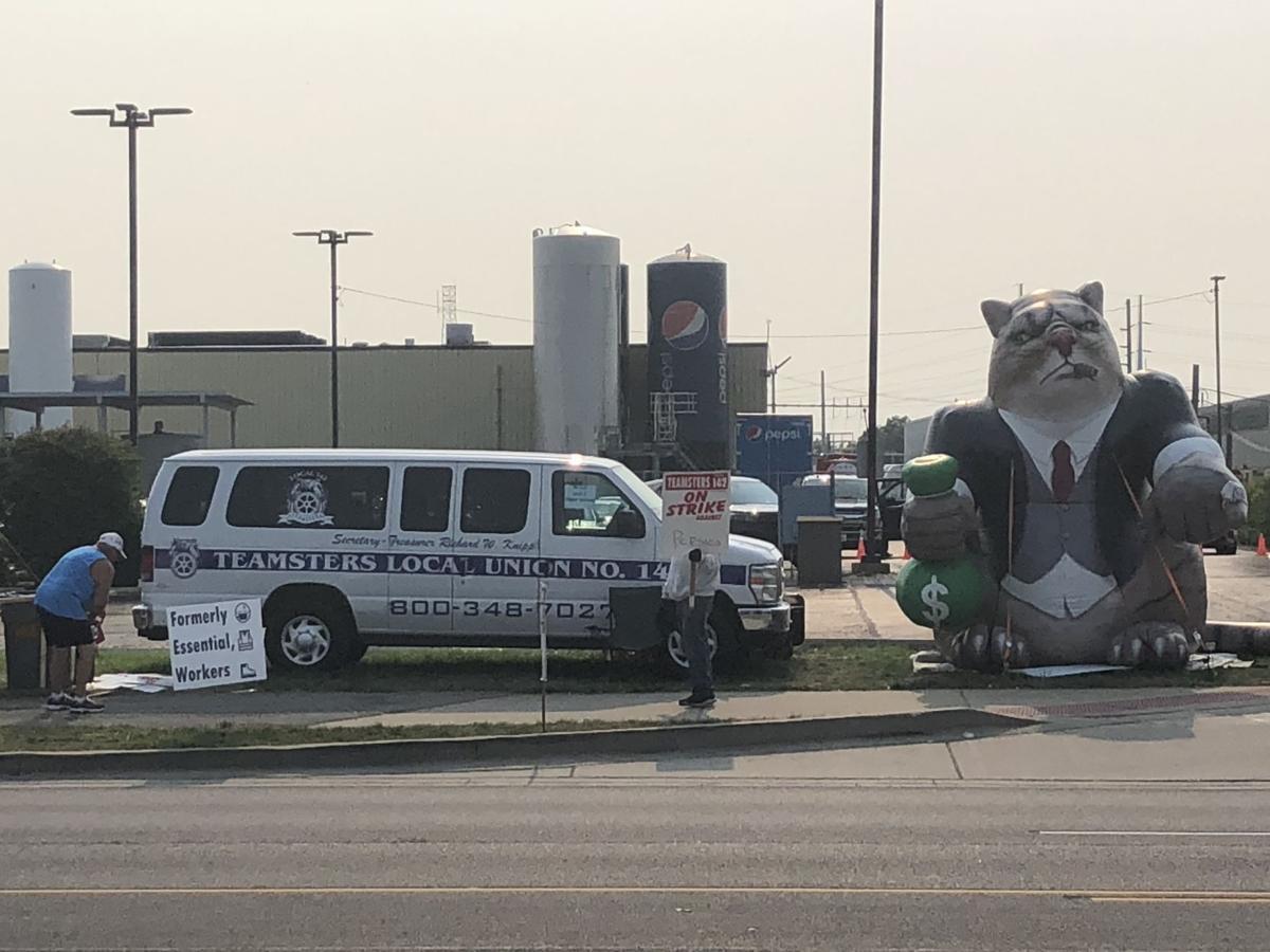 Striking Pepsi drivers install inflatable fat cat, seek to resume talks