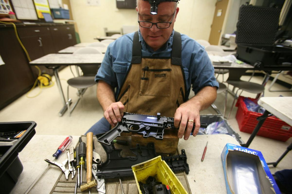 Gun coroners' destroy seized weapons to get them off the