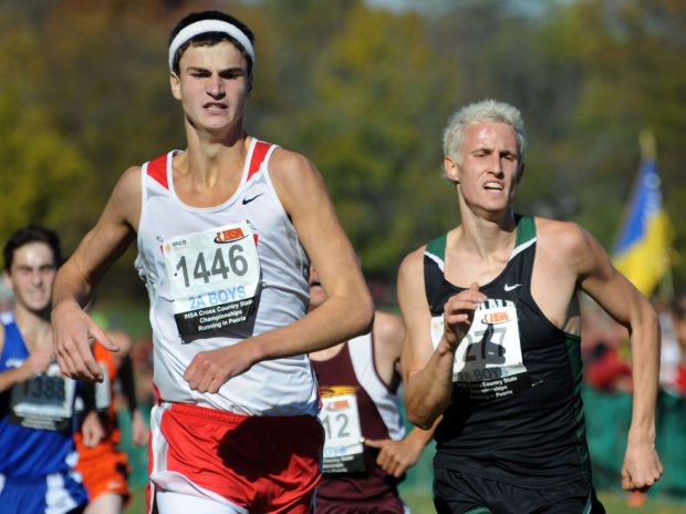 Morton junior Brady Carius, left, and Illiana Christian senior Tony Wondaal, right, race to the finish line during the IHSA Boys Class 2A cross country state meet Saturday at Detweiller Park in Peoria.