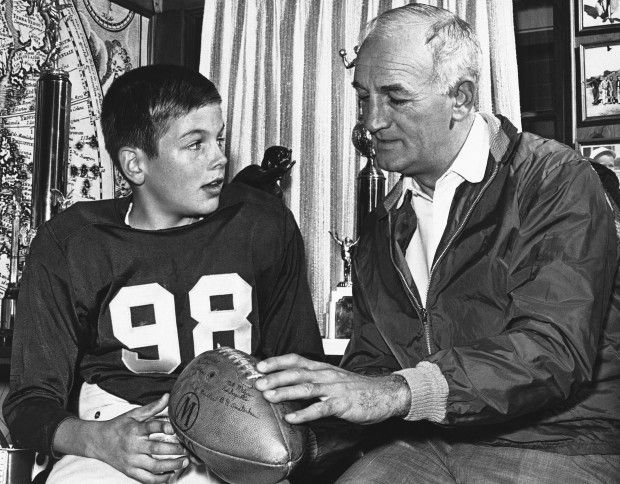 Mark Harmon, left, and father Tom Harmon