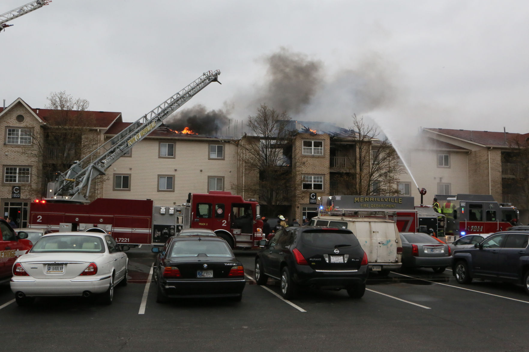 Firefighters Work To Extinguish A Blaze At The Lakes Apartment Complex.