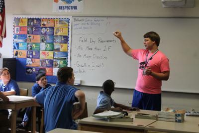 Clark Middle School teacher Nathan Miller built desks for students