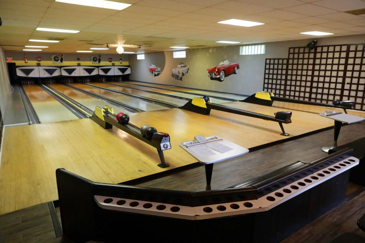 Manual scoring, vintage pinsetters keep bowling alley right at home