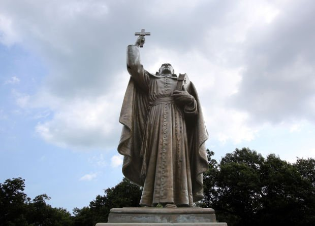 A statue of Father Jacques Marquette stands at the entrance to Marquette Park in Gary