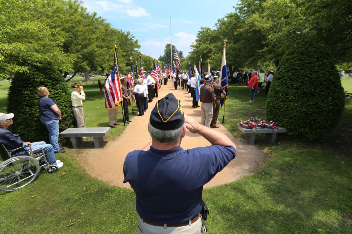 Residents honor fallen veterans at Calumet Park Cemetery