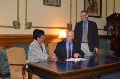 Daniels signs early education study into law