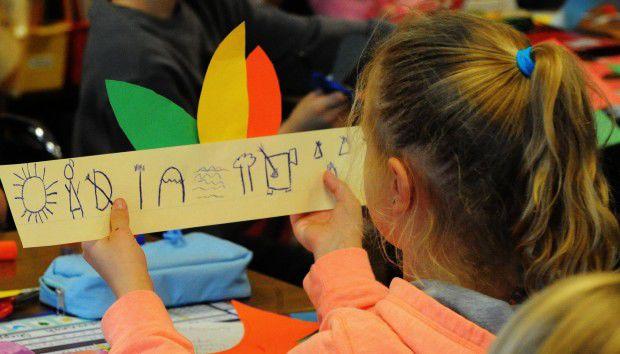 Kids talk turkey during pre-Thanksgiving Day activities in Hobart, Cedar Lake