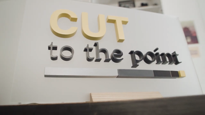 Cut to the Point sign