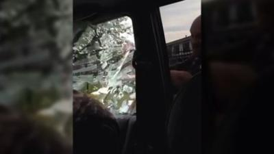 Screen grab from video of Hammond PD smashing car window, Tasering passenger