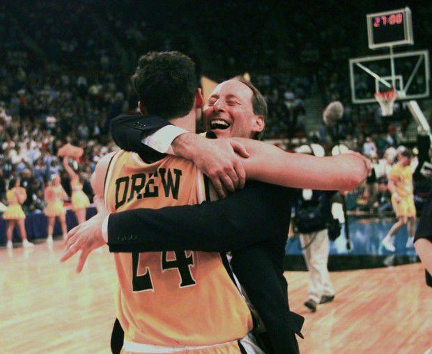 Valparaiso's head coach Homer Drew hugs his son, Bryce Drew