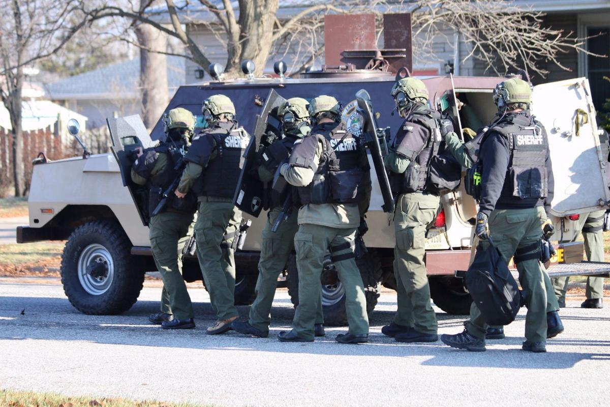 UPDATE: Man behaved oddly before standoff with police in Highland