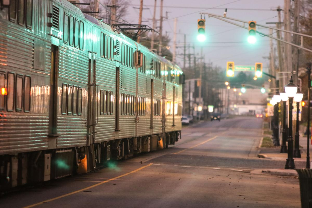 South Shore trains share 11th St. in Michigan City with pedestrian and vehicular traffic