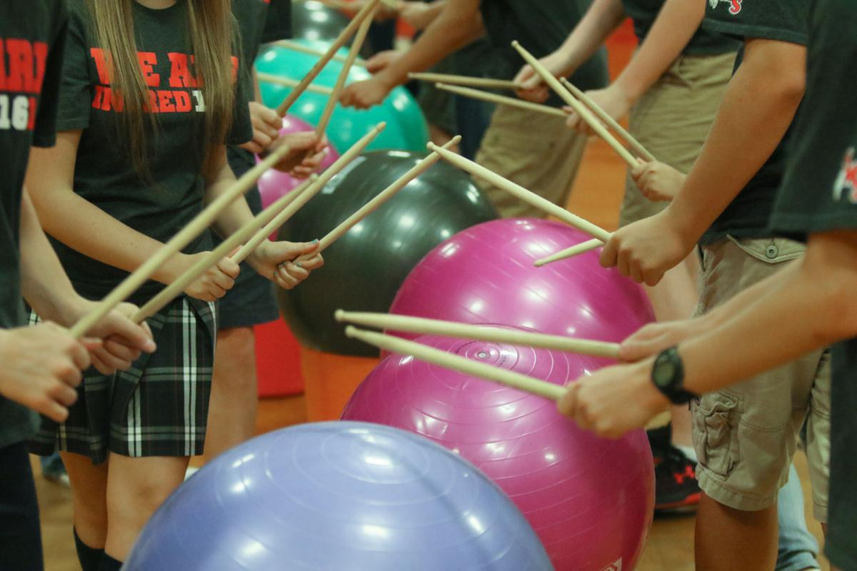 St. Michael School 8th-graders demonstrate a DrumFIT routine