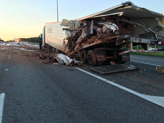 Cocoa powder, jugs of pool chemicals and batteries on roadway after I-94 crash near Burns Harbor
