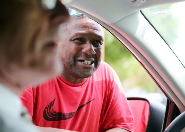 Local resident Leonard Jackson chats with Kenosha Mayor Keith Bosman.
