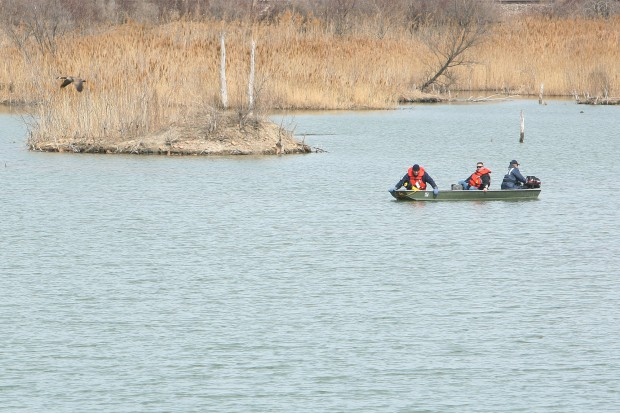 Dive team searches pond for clues in missing doctor case