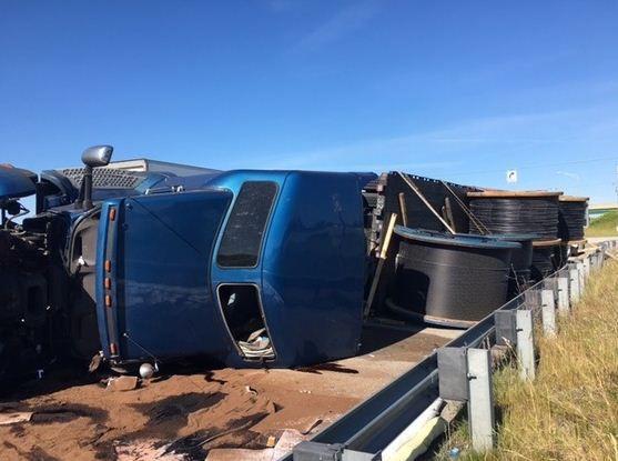 Semi driver, passenger injured in rollover crash