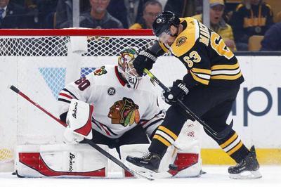 Bruins beat Blackhawks 6-3, snap Chicago's 7-game win streak