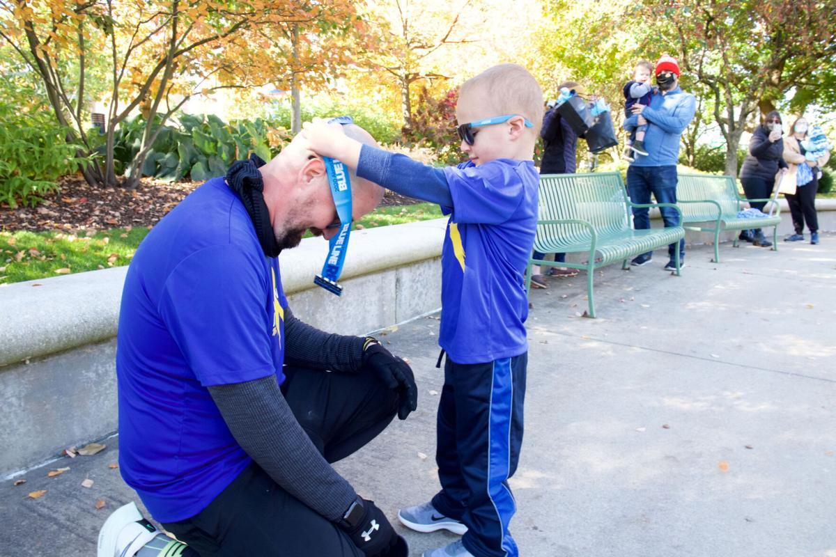 An Ohio dad runs his first marathon around hospital for 4-year-old son with cancer