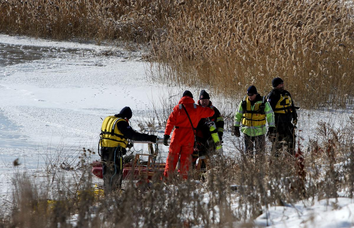 Rescue teams battle ice, frigid weather to recover body, car