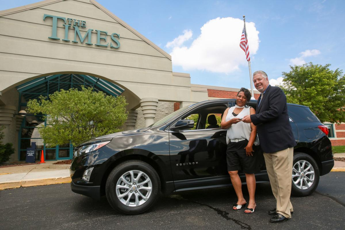 Presentation of new Chevy to Times/Chevy contest winner Lolita Whitehead