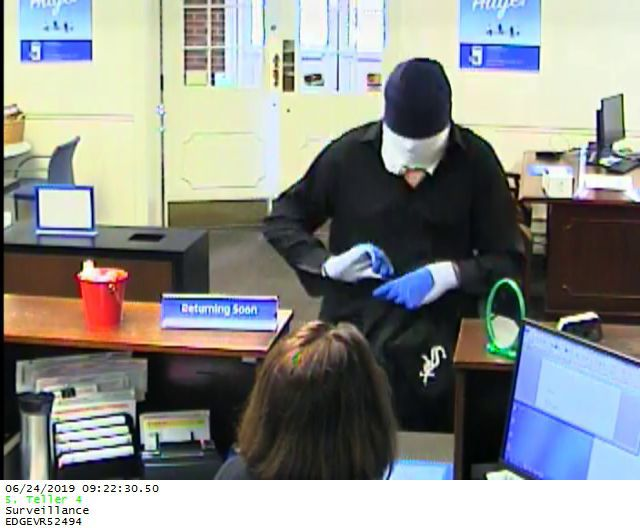 Images of masked bank robber released by police