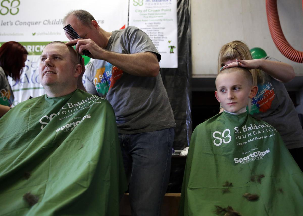 Marc Chase of The Times shaves his head for St. Baldrick's