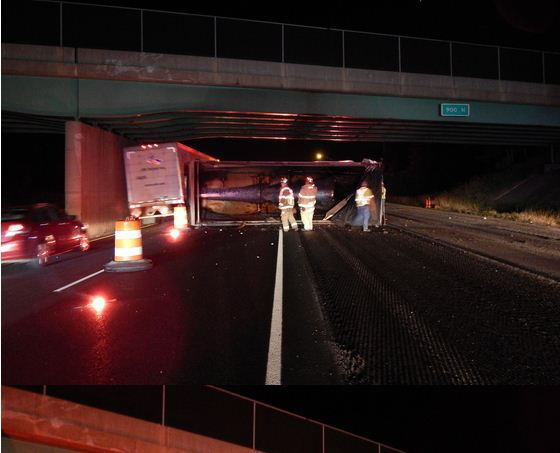 Truck driver forgets to lower dump trailer hits bridge for Laporte county state of emergency