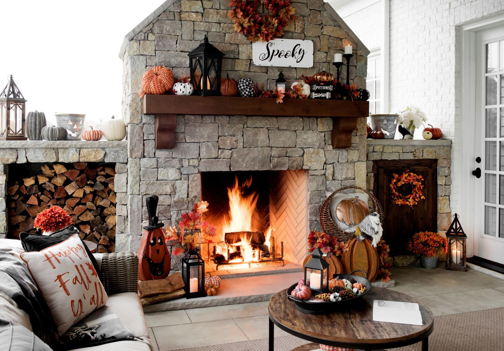 Pumpkins On The Hearth, A Fall Throw Pillow, Maple Leave Wreaths, And A  U201cSpookyu201d Sign Are Simple Moves That Create A Seasonal Feeling At Home.