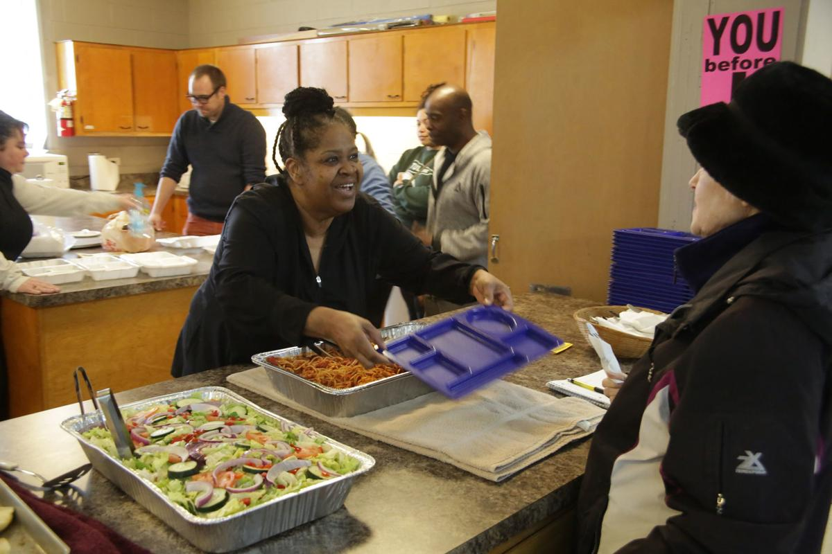 Volunteer vets make meal for those in need
