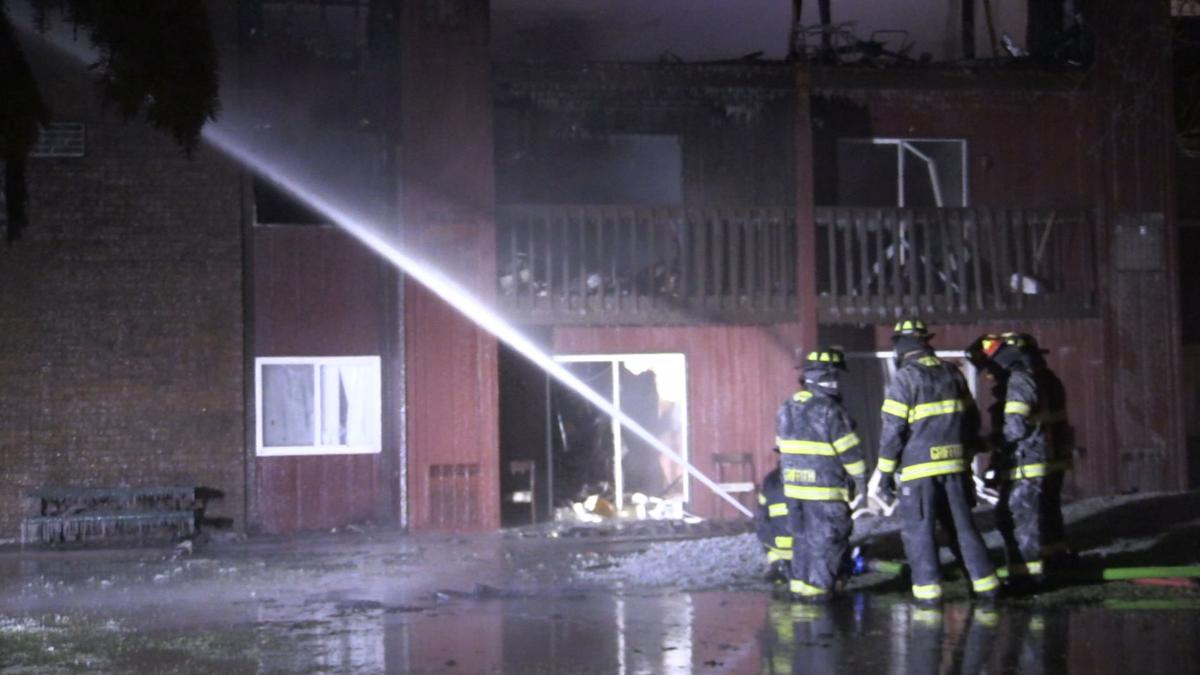 Firefighters continue to battle apartment building fire