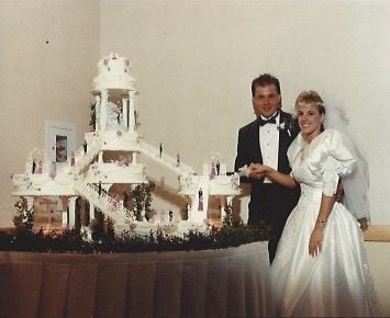 Ted and Renee Schilling with Ida Bruder's Wedding Cake Creation on May 18, 1991