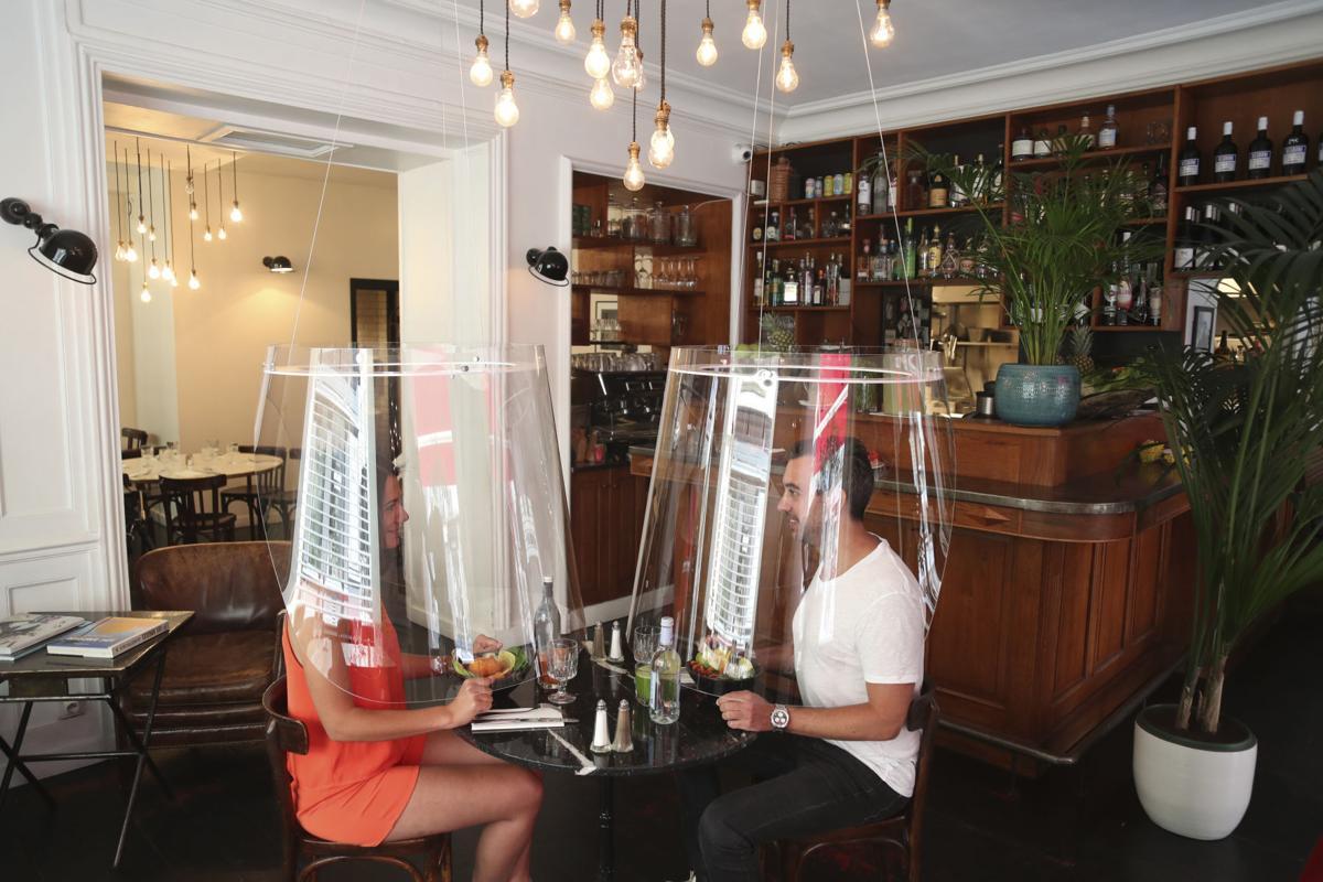 APTOPIX Virus Outbreak France Future of Dining
