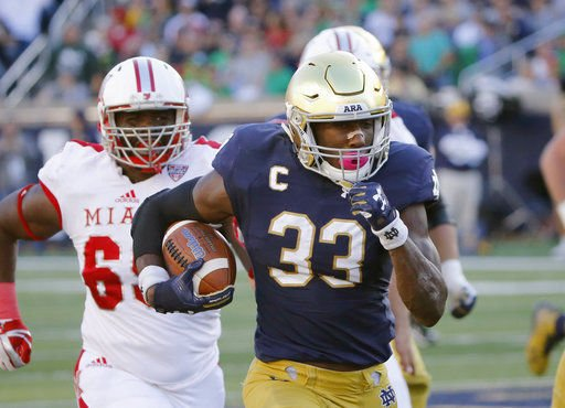 Notre Dame grounded about playoff, Heisman talk