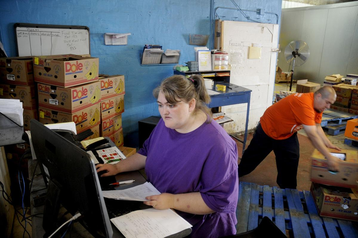 IMPACT trainees work at the Food Bank of Northwest Indiana in Gary, Ind. Tuesday Sept. 1, 2015.   Stephanie Dowell, The Times