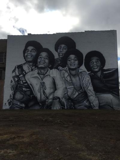 Four-story Jackson 5 mural towers in downtown Gary