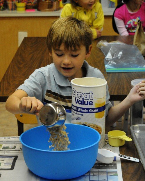 Young chefs whip up biscuits to aid Portage pantry for needy pets