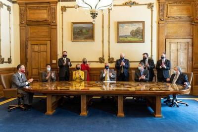 Governor signs broad COVID-19 legal liability shield into law