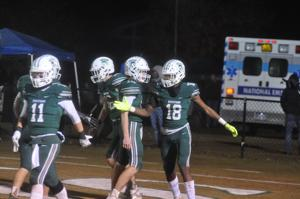 Spartans survive a late rally to reach semis
