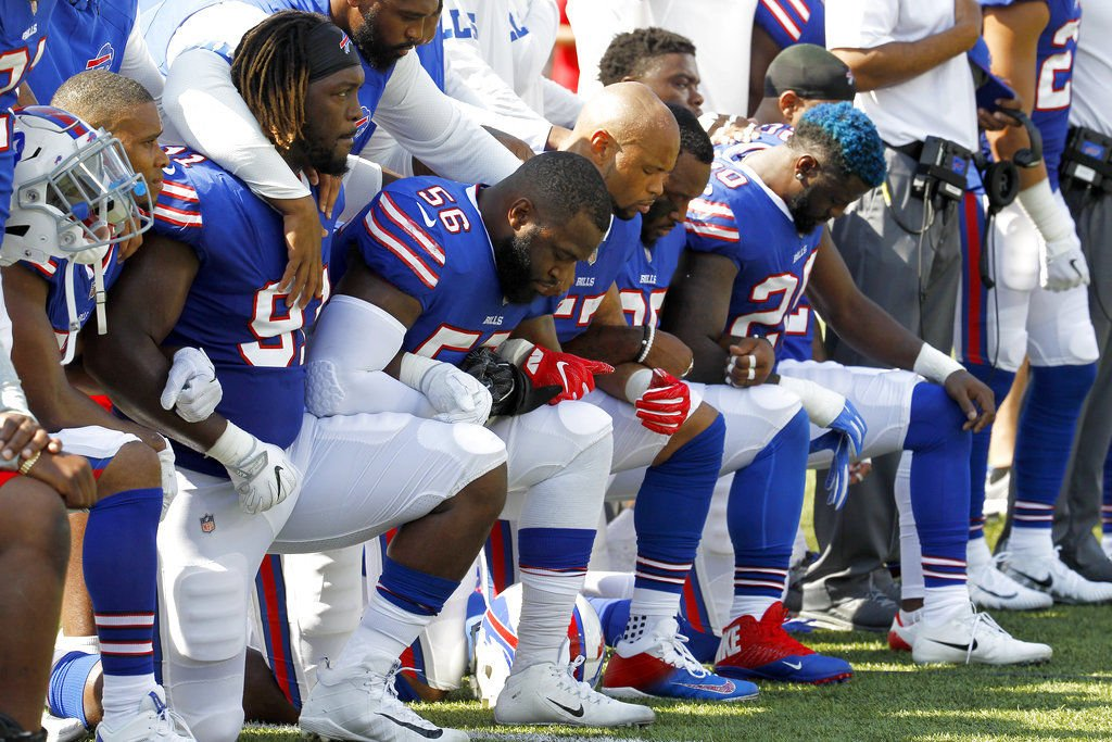Most of the Broncos kneeled during the national anthem