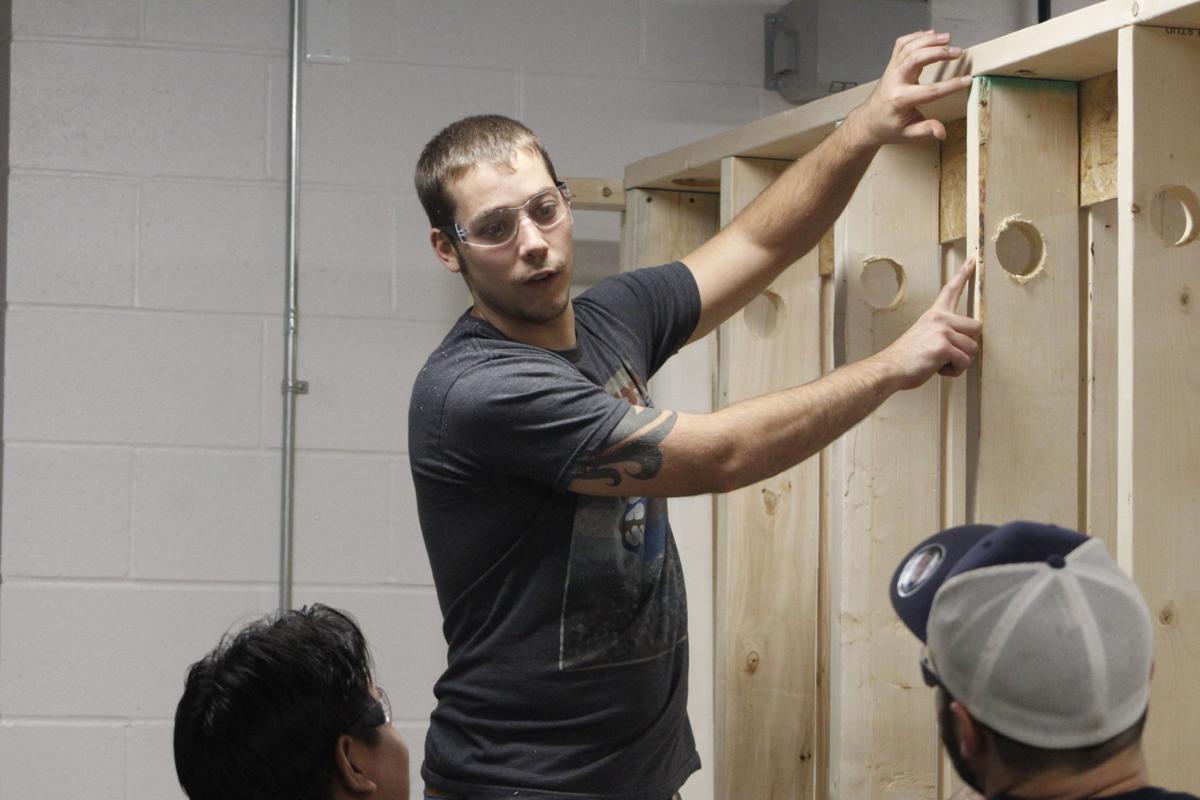 Steve Sprague 28 Of Olean One 14 Students In Jamestown Community Colleges Residential Plumbing Program Works On Drilling Holes Wall Studs