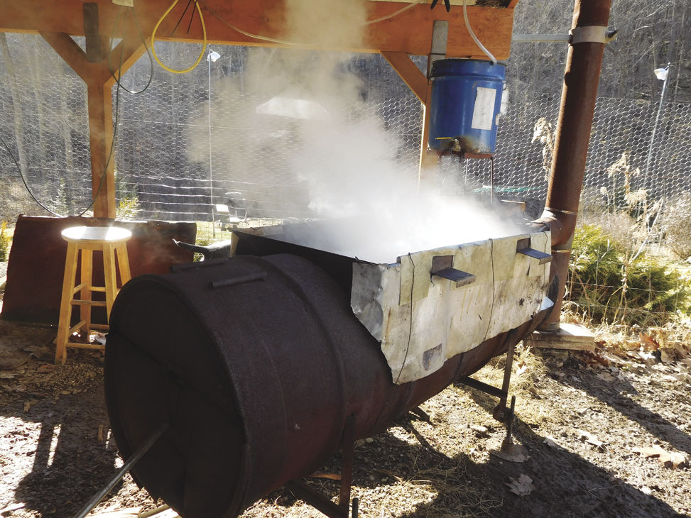 A Wood Fire Has The Tray Of Maple Sap Boiling Briskly As Cloud Steam Shows It Takes 35 To 50 Gallons Make 1 Gallon Syrup