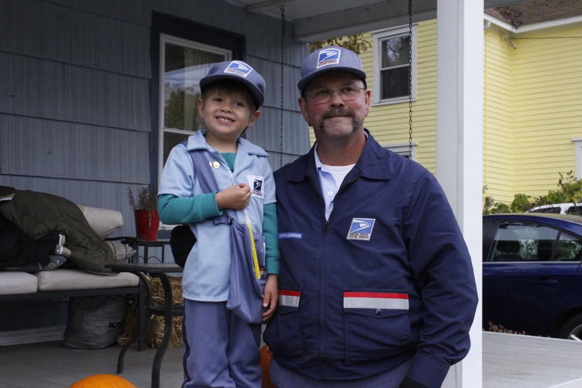 mail carrier Steve Roberts and 4-year-old Brennan Brushingham