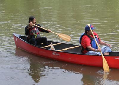 Senecas paddling down Allegheny River