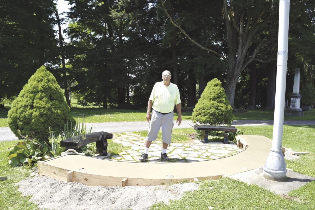 Ron Washburn is shown working on the Scio Veterans Memorial at Fairlawn Cemetery. The memorial will be dedicated at 11 a.m. Monday in the cemetery.