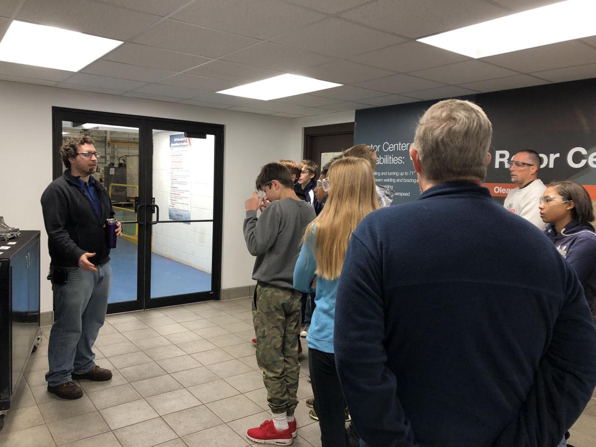 Sean Frier, manufacturing engineer at Dresser-Rand, shows Olean High School freshmen around their facilities as part of Dream It Do It Western New York's Manufacturing Day.