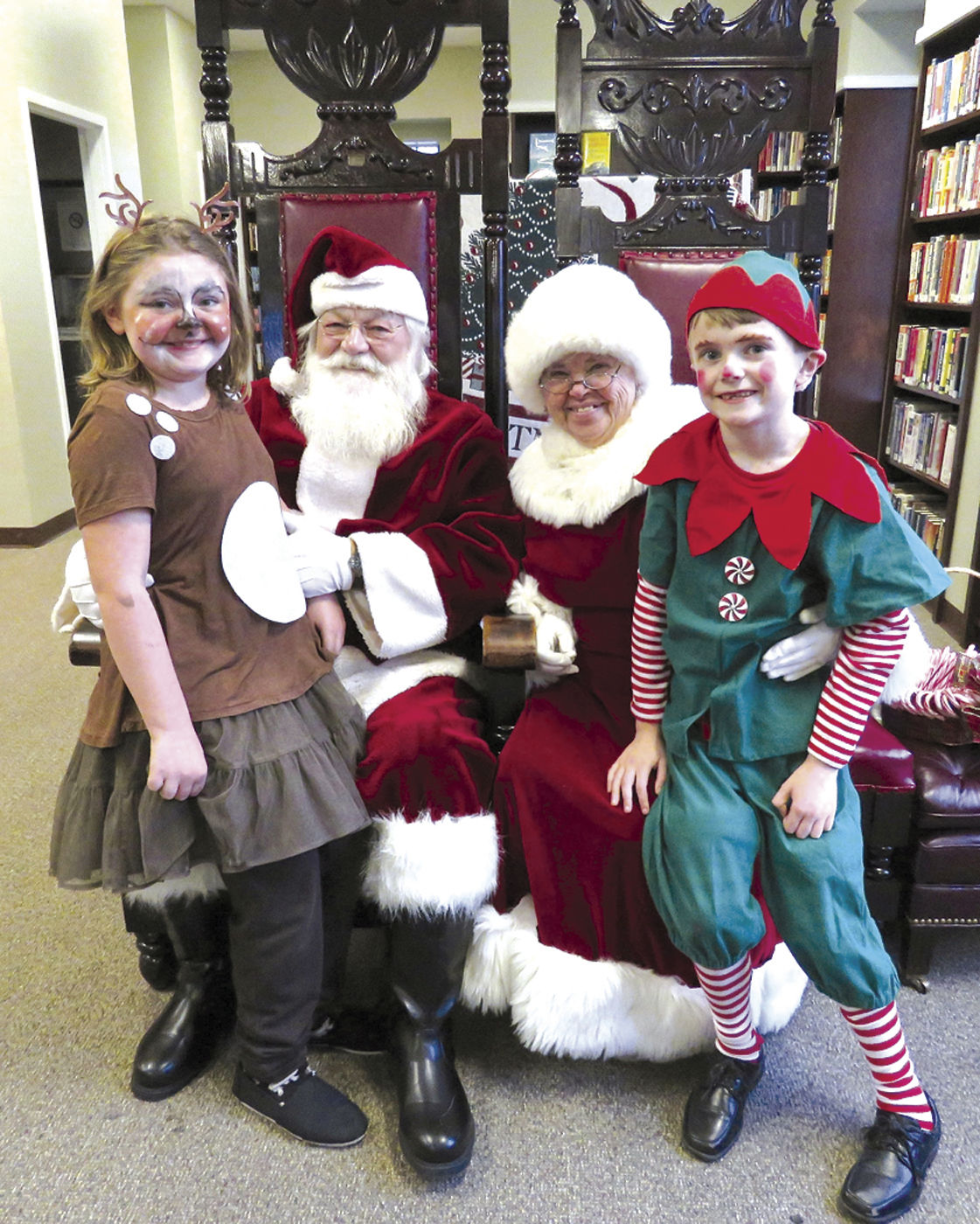 santa and mrs claus come around this time of year to greet children and listen to their wish lists shown are santa and mrs claus played by doug nottis